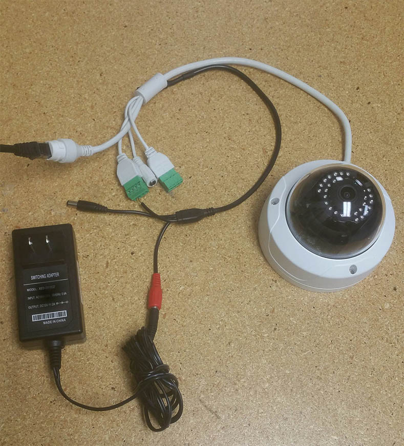 An IP camera powered via POE and a Pre-Amplified Microphone powered via a 12v adapter.