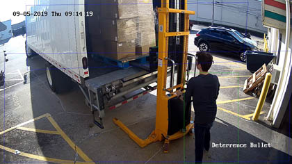 Our active deterrence security cameras recognize both vehicle and human movement. Here is a human with the green recognition box.