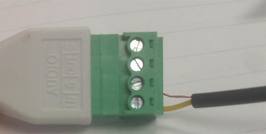 Insert the yellow wire into the audio in input and the bare wire into the ground input.