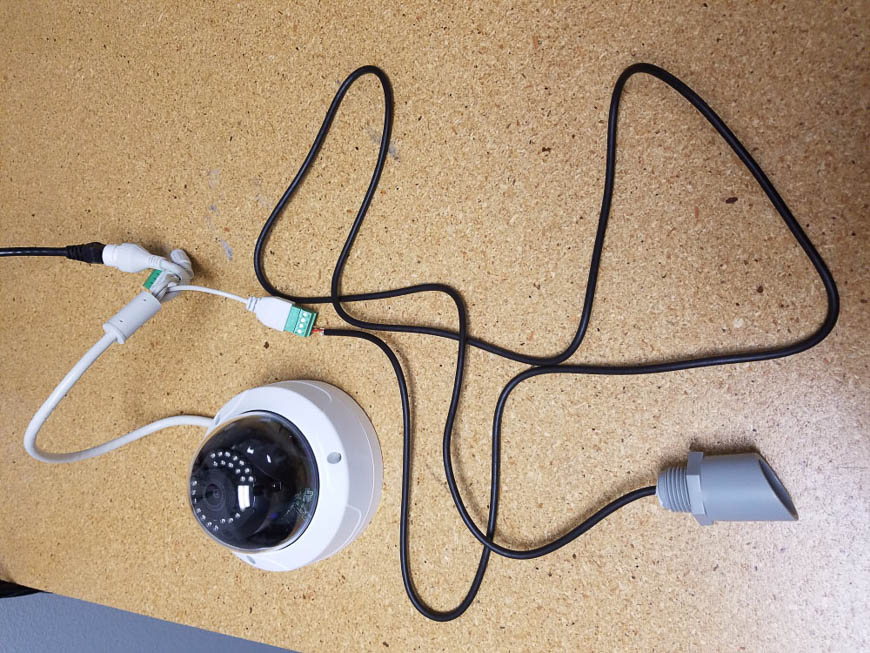 An Un-Pre-Amplified Microphone connected to an IP camera powered through Power of Ethernet (POE)