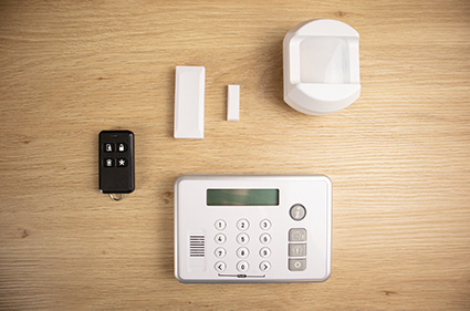 The Rely alarm panel, PIR motion detector, 3 door/window sensors, and a keychain remote.