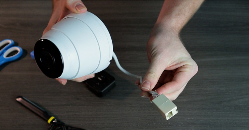 You can make your own security camera pigtail out of a crimped cable and an Ethernet coupler.