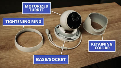 The motorized turret comes apart into four pieces: the camera, the base, the retaining collar, and the tightening ring.